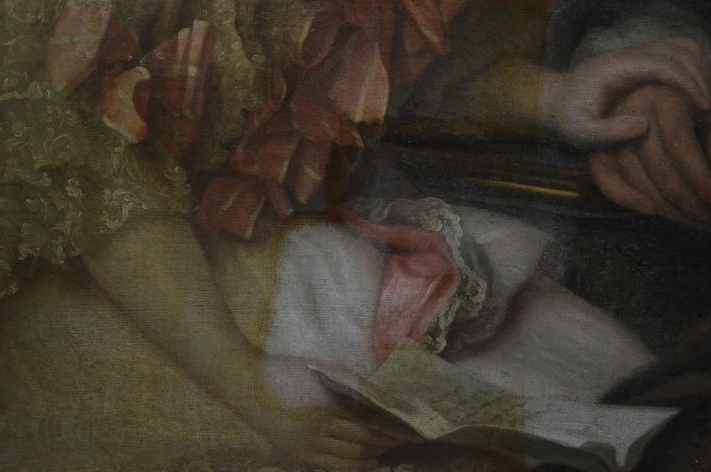 Dévernissage en cours d'une peinture XVIIIème.
